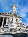 Austria vienna parliament the in with the statue of pallas athene the greek goddess of wisdom Stock Photography