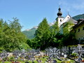 Austrian alps outlook cemetery church zederhaus background peaks alps Royalty Free Stock Photo