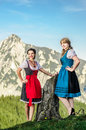 Austrian beauties with traditional clothes in the alps Stock Images