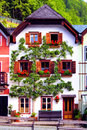 Austrian house traditional with flowers in hallstatt village austria Royalty Free Stock Images