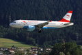 Austrian a landing an airlines airbus is at innsbruck airport hillside in the background Stock Photo