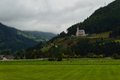 Austrian landscape with a small church and green fields Stock Photos