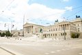 Austrian parliament building square and monuments in vienna on sunny day Royalty Free Stock Images