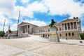Austrian parliament building and statue on one of downtown squares Royalty Free Stock Photo