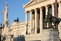 The austrian parliament in vienna austria and athena fountain Royalty Free Stock Photo