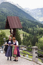 Austrian women in folkloristic costumes maria luggau dressed typical clothes are reading about our lady of snows pilgrimage church Stock Image