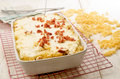 Authentic hungarian noodle casserole on a cooling rack with grilled bacon and cottage cheese Stock Photos