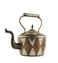Authentic metal teapot vessel isolated covered with ornaments over white background Royalty Free Stock Image