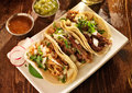 Authentic mexican taco meal barbacoa carnitas and chicken tacos Stock Photo