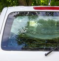 Authentic trace after being shot with rifle on the rear window of car close up Royalty Free Stock Photos
