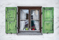 Authentic window with green wooden shuttters in a small town of garmisch partenkirchen bavarian alps germany Royalty Free Stock Photos