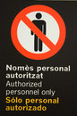 Authorized personnel only poster written in english spanish and catalan Royalty Free Stock Photo