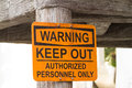 Authorized sign yellow warning for personnel only Royalty Free Stock Photo