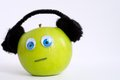 Autism apple series this is a green with the green is wearing ear phones in order to control its sensory input the green is Royalty Free Stock Photos