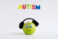 Autism apple series this is a green with the green is wearing ear phones in order to control its sensory input the green is Stock Photos