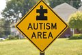 Autism area sign a warning motorists of an Stock Photos