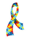 Autism awareness ribbon a illustration of an made with a symbolic jigsaw puzzle pattern in colors vector eps available eps Royalty Free Stock Photos