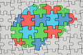 Autism concept, brain from colored puzzles, 3D rendering