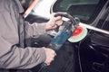 Auto mechanic buffing car autobody Royalty Free Stock Photo
