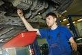 Auto mechanic disassembling axle Royalty Free Stock Photo