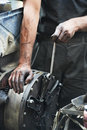 Auto mechanic hands at car repair work Royalty Free Stock Photo