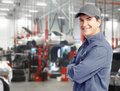 Auto mechanic repair service handsome smiling Stock Photography