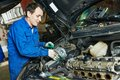 Auto mechanic repair turbine repairing automobile car engine at maintenance service station garage Stock Photos