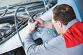 Auto mechanic repairing car autobody bonnet Royalty Free Stock Photo