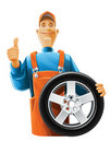 Auto mechanic with wheel Royalty Free Stock Image