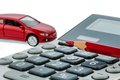 Auto red pen and calculator a car a is on a cost of gasoline wear insurance car costs are not paid by commuter tax Royalty Free Stock Photos