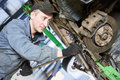 Auto repair service. Mechanic works with car suspension Royalty Free Stock Photo