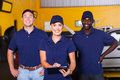 Auto repair workers group of happy in shop Stock Photography