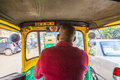 Auto rickshaw taxi driver in delhi india nov india these iconic taxis have recently been fitted with cng powered engines Stock Image