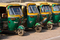 Auto rickshaw taxis in agra india november on a road on november these iconic have recently been fitted with cng Royalty Free Stock Photos