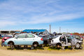 Auto salvage yard junkyard the scene shows many cars and other automobiles in a junk where customers can pick and choose part for Stock Photography