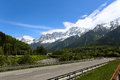 Autobahn straight going to the mountains at the sunny day Stock Image