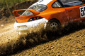 Autocross on a dusty road close up of car in competition up dirt powerful auto throws dirt Royalty Free Stock Photography