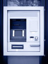 Automated teller machine in blue tone vertical format Royalty Free Stock Photos