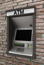 Automated teller machine on a brick wall Royalty Free Stock Photography