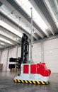 Automated warehouse (paper) with robotic forklift Stock Photos