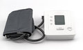 Automatic digital blood pressure monitoring meter on white backg Royalty Free Stock Photo