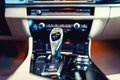 Automatic gear shifter in a, modern car. Car interior details Royalty Free Stock Photo