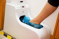 Automatic shoe cover protective case for the purpose of sterility and hygiene Royalty Free Stock Photo