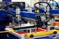 Automatic t-shirt screen printing rotary machine Royalty Free Stock Photo