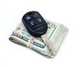 Automobile purchase. Money and car key. Royalty Free Stock Photo