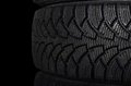 Automobile tire on black background the a Royalty Free Stock Photos