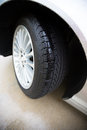 Automobile tire wet on a concrete pavement treads are showing clearly with rain in them Royalty Free Stock Photo