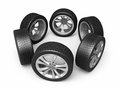 Automobile tires and wheels Stock Images