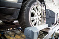 Automobile wheel alignment at workshop with focus on the and equipment Stock Images