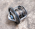 Automotive thermostat valve old used broken removed from the car Stock Image